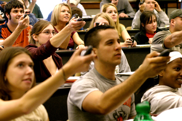 An image of students using clickers